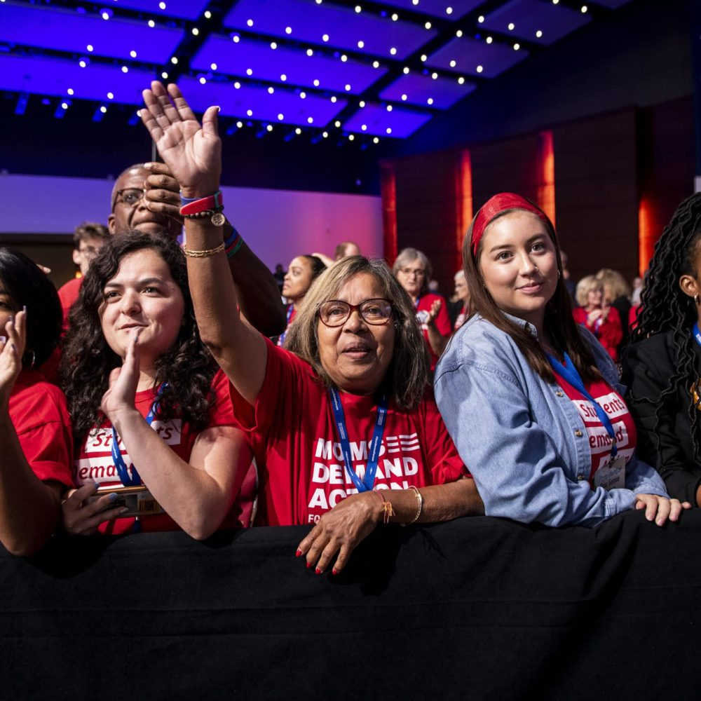 A group of Moms Demand Action volunteers stand front row at the Presidential Gun Sense Forum in 2019